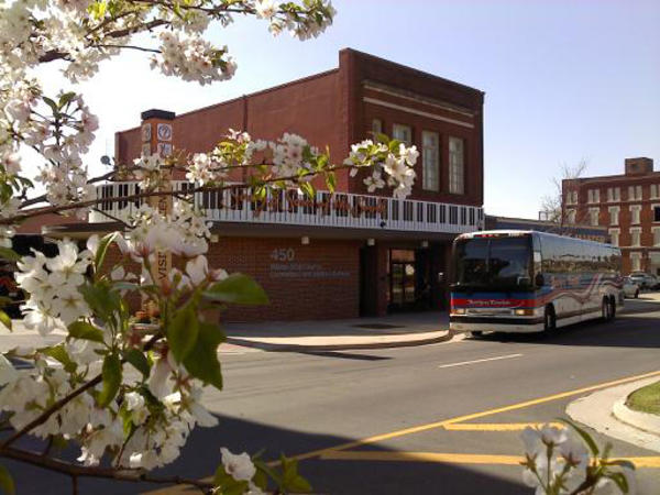 Downtown Visitor Center in Macon, GA with cherry blossoms in the foreground