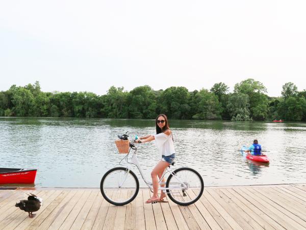 Jane biking on the dock at Lady Bird Lake