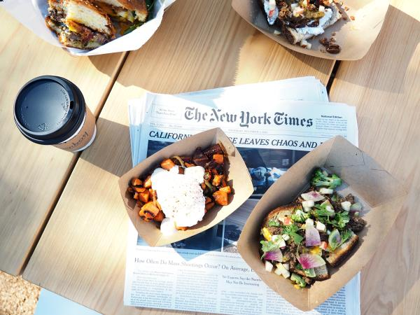 Breakfast at paperboy along with a cup of coffee and the New York Times