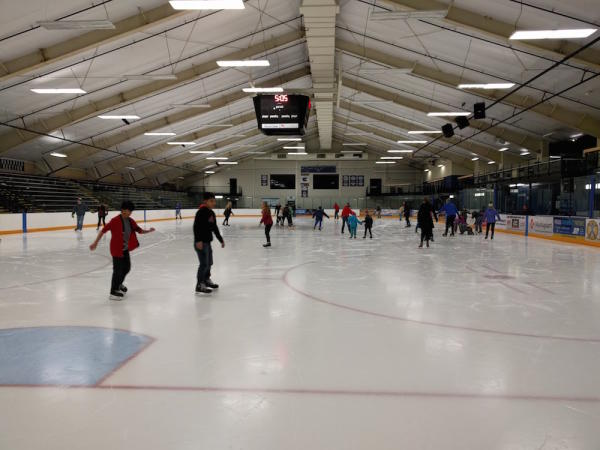 People Ice Skating at Hobbs Ice Arena