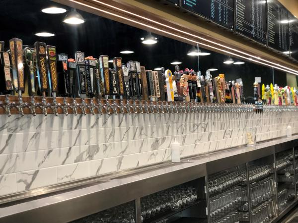 Bar at Growler USA with 102 beers