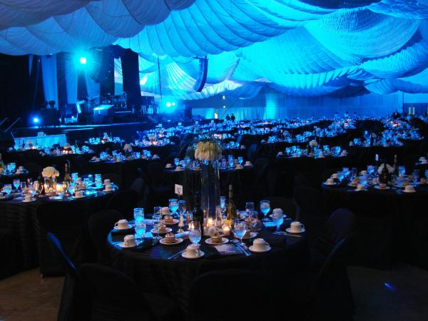 Meeting Room With Blu Ornaments and Tables Set Up With Plates And Silverware