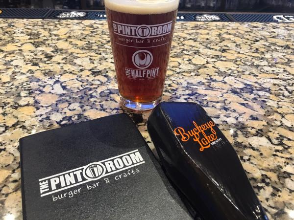 A Pint glass, Buckeye Lake tap handle and The Pint Room menu.