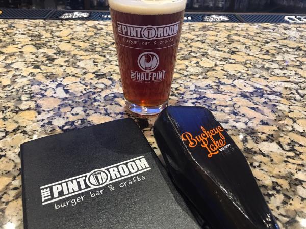 A Pint glass, Buckeye Lake tap handle and The Pint Room menu.