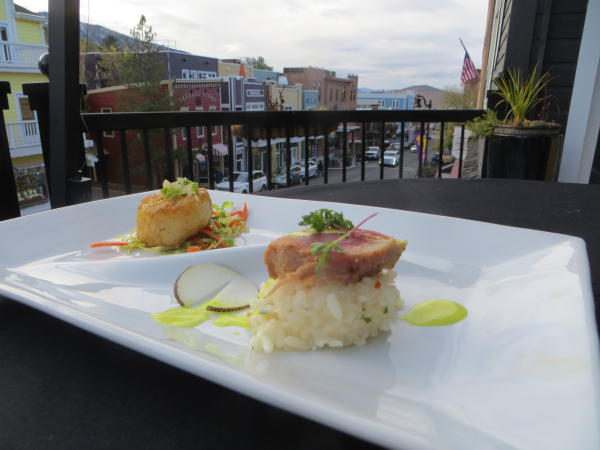 Seared Scallops on a plate with old town in the background