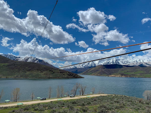 scenic view of mountains with zip lines over water