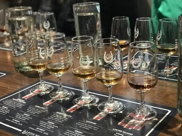 tasting flight of whiskey in glasses