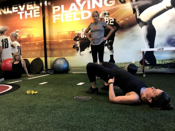 Instructor demonstrating a hip exercise