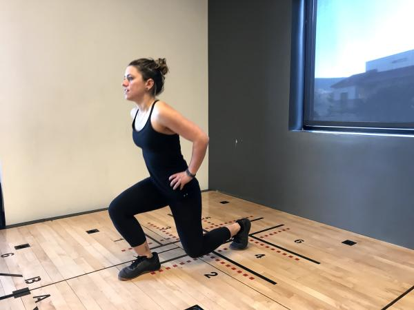 Instructor demonstrates a lunge