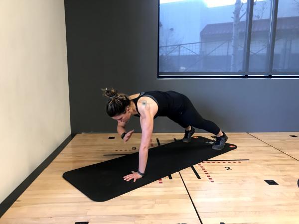 Instructor demonstrates shoulder taps