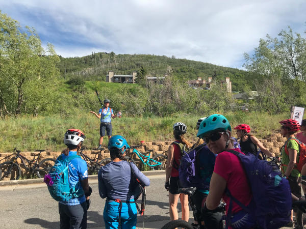 guide talking to a group of riders
