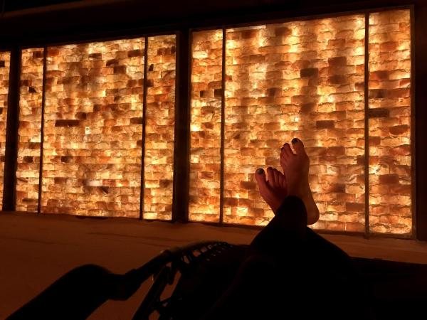View of a woman's feet and the wall inside the salt room