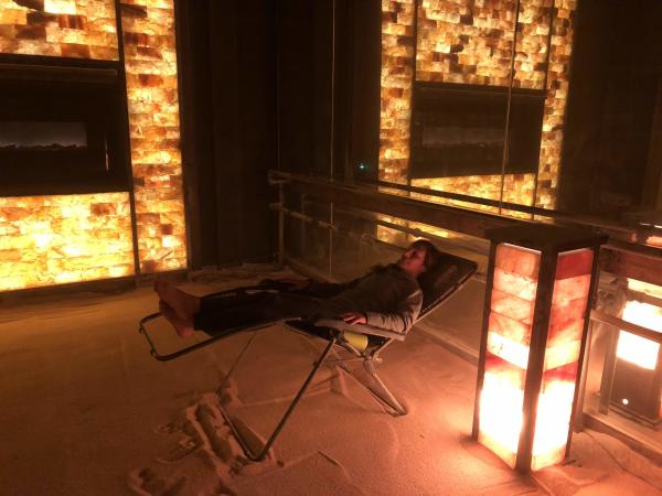 Woman in zero gravity chair in room filled with salt