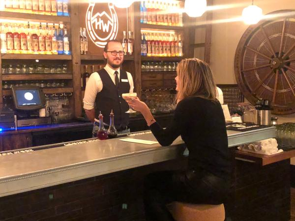 Writer Locke Hughes chats with bartender