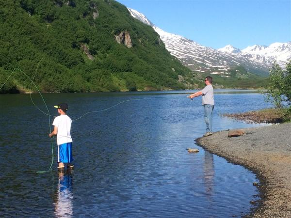 people fishing in a freshwater alpine lake