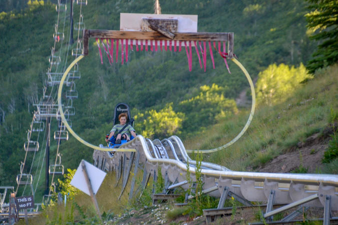 boy riding on alpine coaster