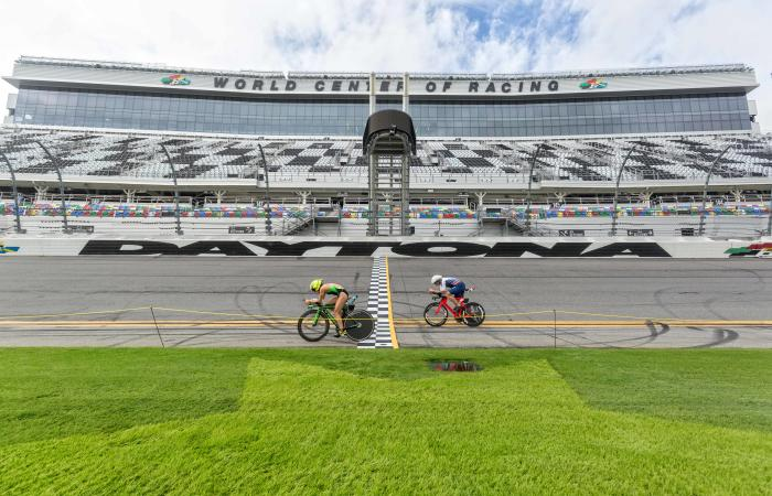 Two bicyclists racing at Daytona International Speedway during CHALLENGEDaytona Triathlon
