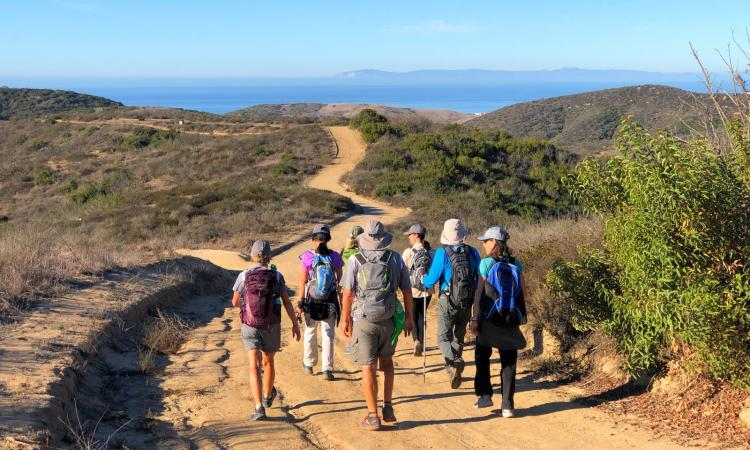 A group of hikers enjoy the sights along the Mountains to the Sea trail.