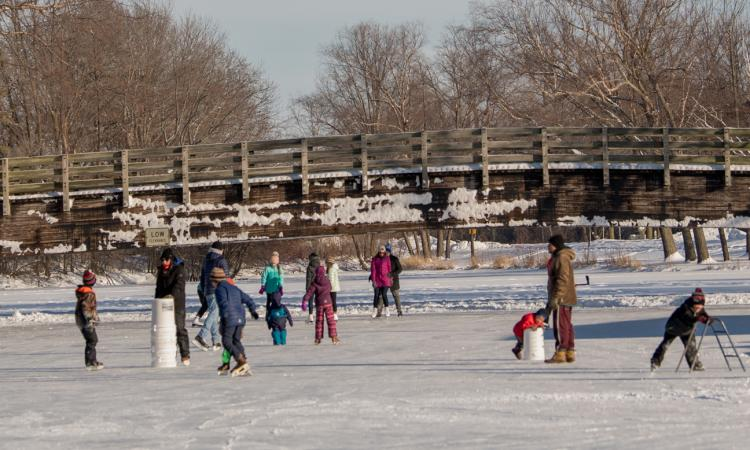 People skate and play on the ice at Vilas Park.