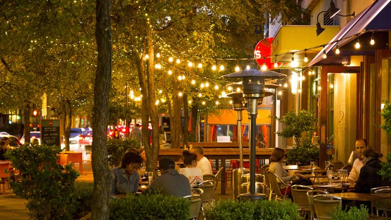Sidewalk Cafe with string lights at night