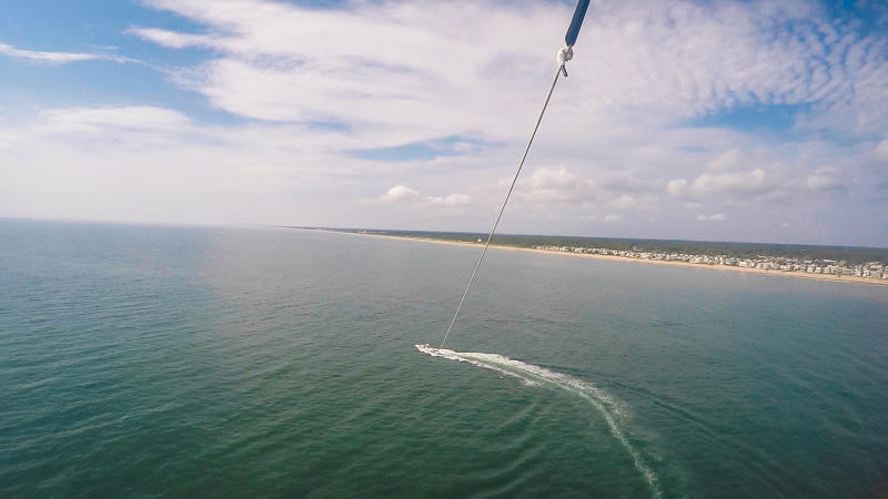 Aerial view of a person parasailing in Virginia Beach