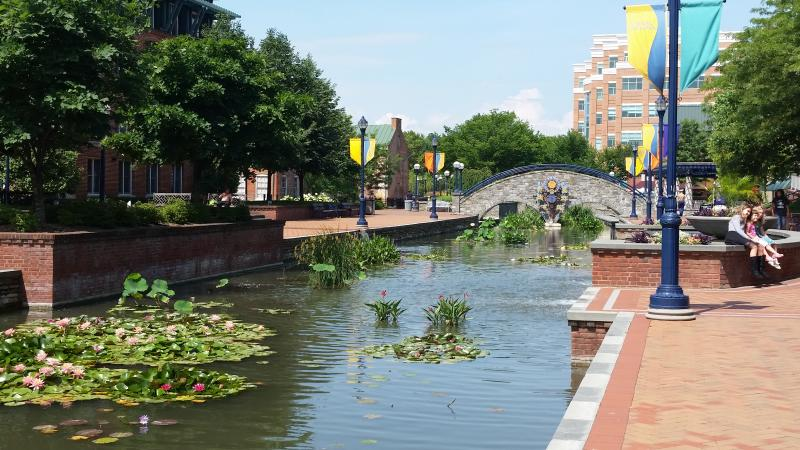 Stone Arch Bridge and channel waterway at Carroll Creek Park