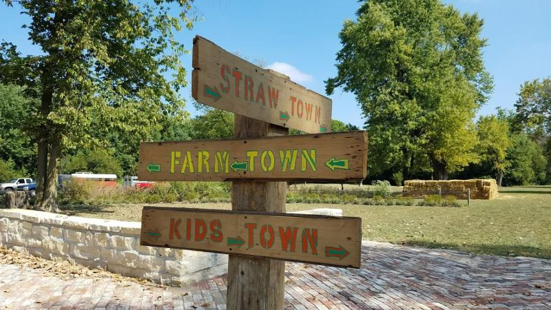 Navigate the straw maze in Straw Town during the Old Town Waverly Park Festival