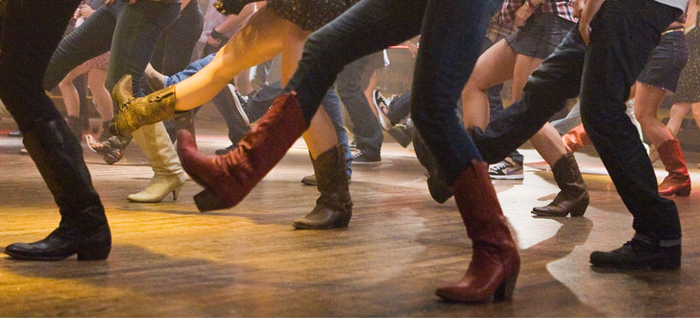 Boots of people participating in country line dancing lessons in Princeton