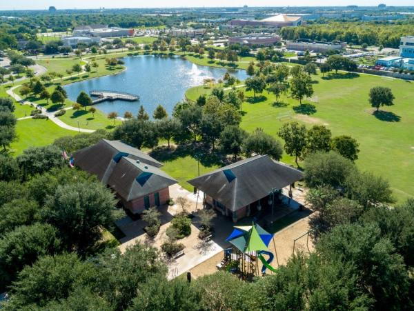 Aerial view of playground and pond at Eldridge Park in Sugar Land, TX.