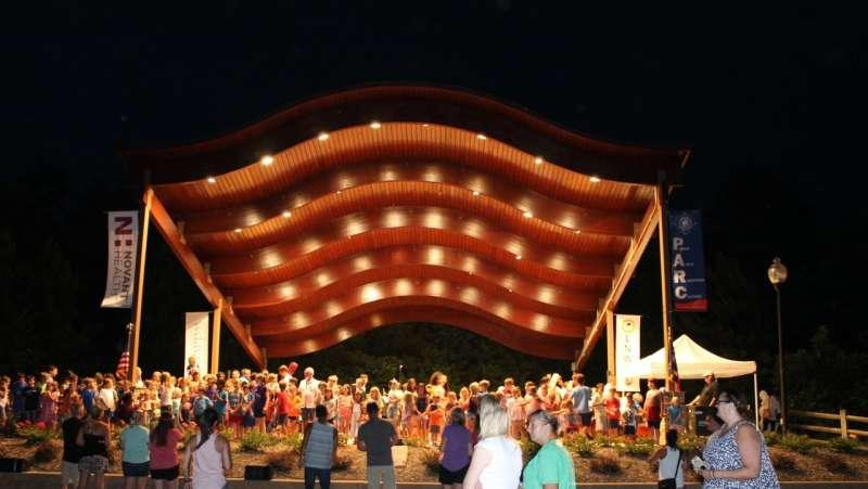 Charlotte Symphony performing at Bailey Road Park at night