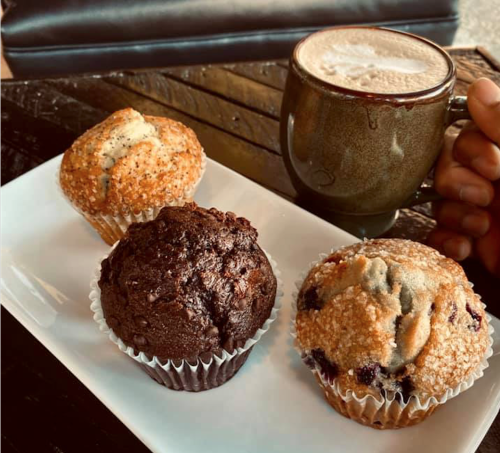 A warm cup of coffee with three different muffin flavors from Third Perk Coffeehouse in downtown Dayton.