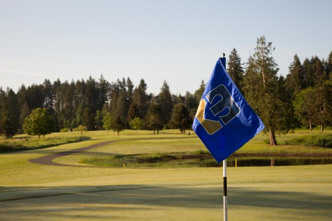 A flag and hills of the Tumwater Valley Golf Course