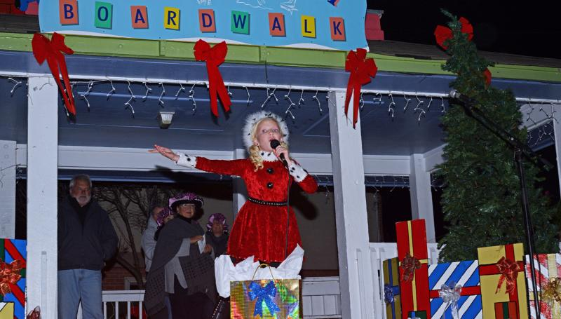 Christmas by the Sea live singer holding a microphone