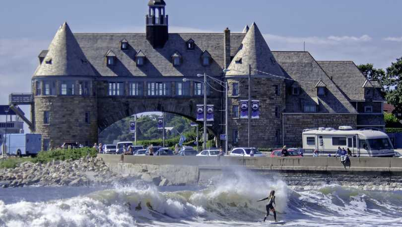 Narragansett Towers and surfer