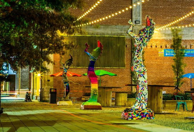 Colorful 10-foot replicas of the Keeper of the Plains line the pop-up park