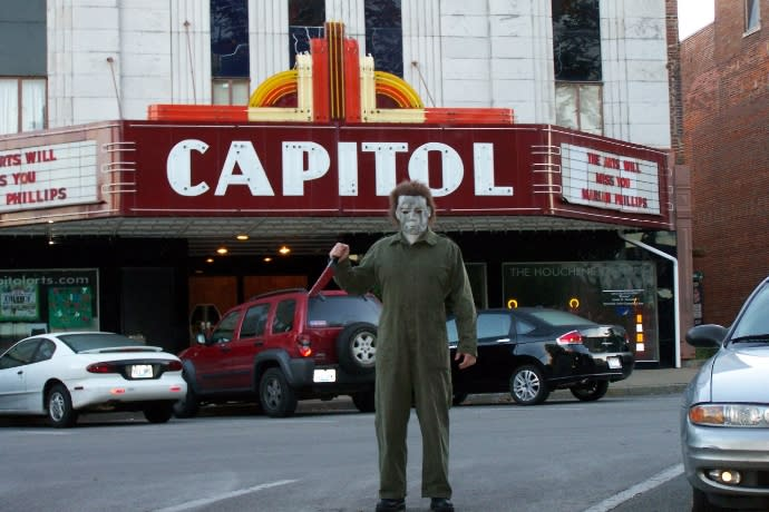 Person dressed as Michael Myers in front of the Capitol Theater in Bowling Green