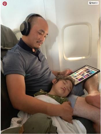 Father & Daughter Sleeping on Plane