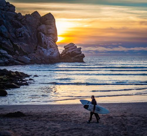 Rock Surfers at Sunset