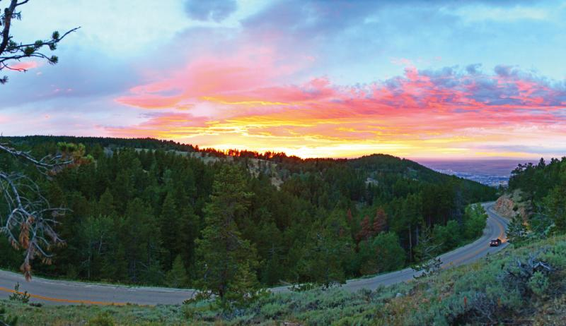 A colorful sunset lights the sky near Casper Mountain.
