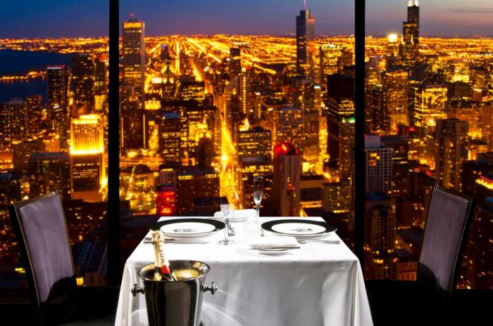 Tablet for two overlooking Chicago at night in The Signature Room at the 95th restaurant