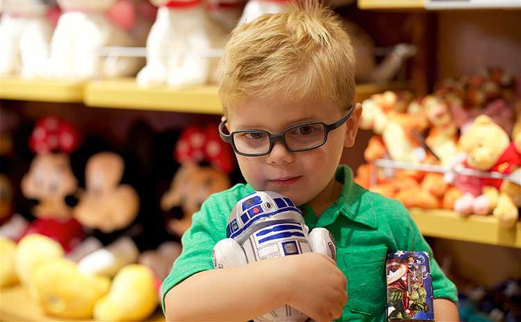 Christmas Shopping Boy holds toy R2D2 at The Disney Store in The Overland Park Oak Park Mall