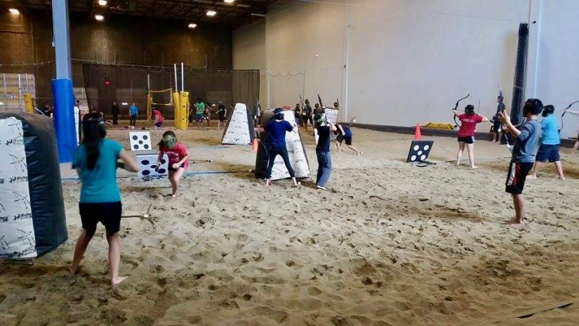 People playing archery tag at 6Pack Indoor Beach
