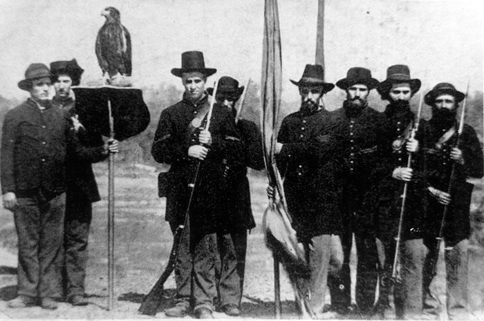 Old Abe on her perch with members of the 8th Wisconsin after the Siege of Vicksburg, Mississippi.