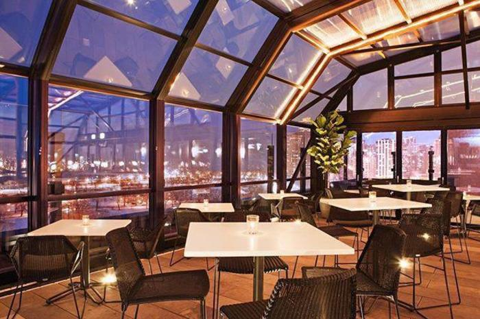 Interior of The J. Parker rooftop restaurant with views of Chicago