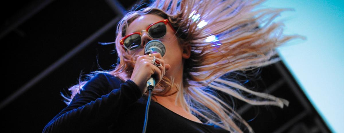 Woman singing at Denver's Underground Music Showcase