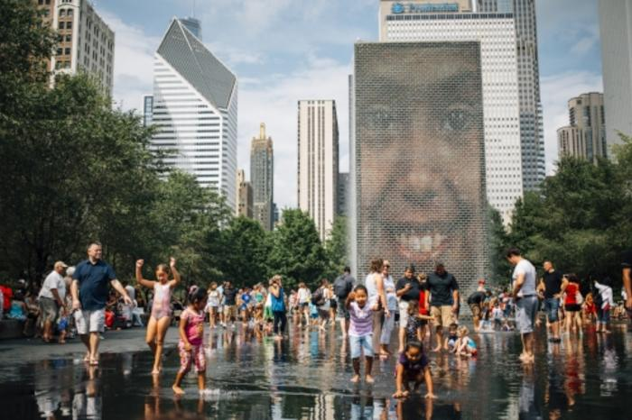 Kids playing in Crown Fountain in Chicago's Millennium Park