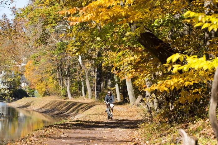 Cyclist along the Delaware Canal in fall