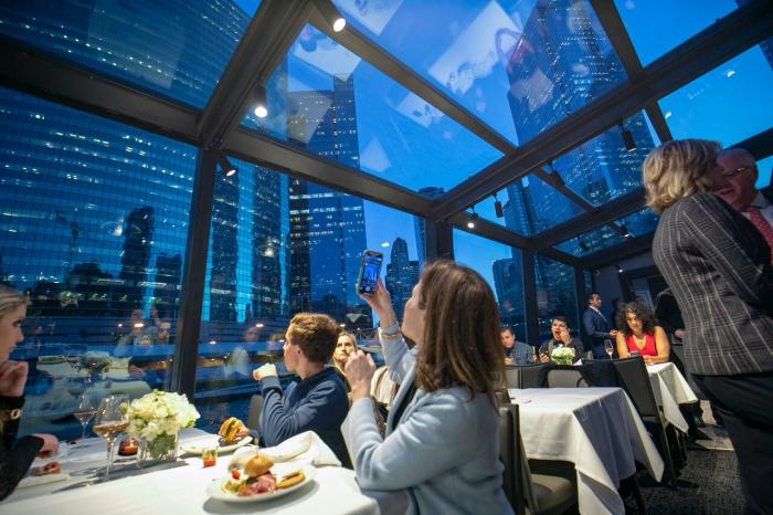 People dining on Odyssey River Cruise with Chicago views