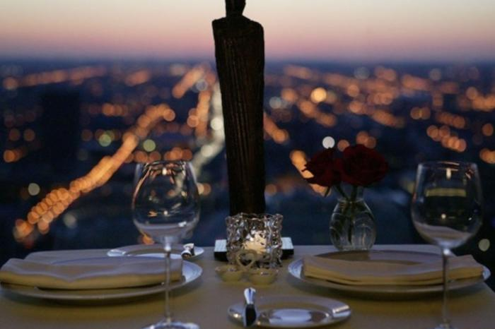 Two person place setting on table overlooking Chicago at Everest restaurant