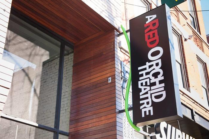 Close up view of A Red Orchid Theatre's street sign